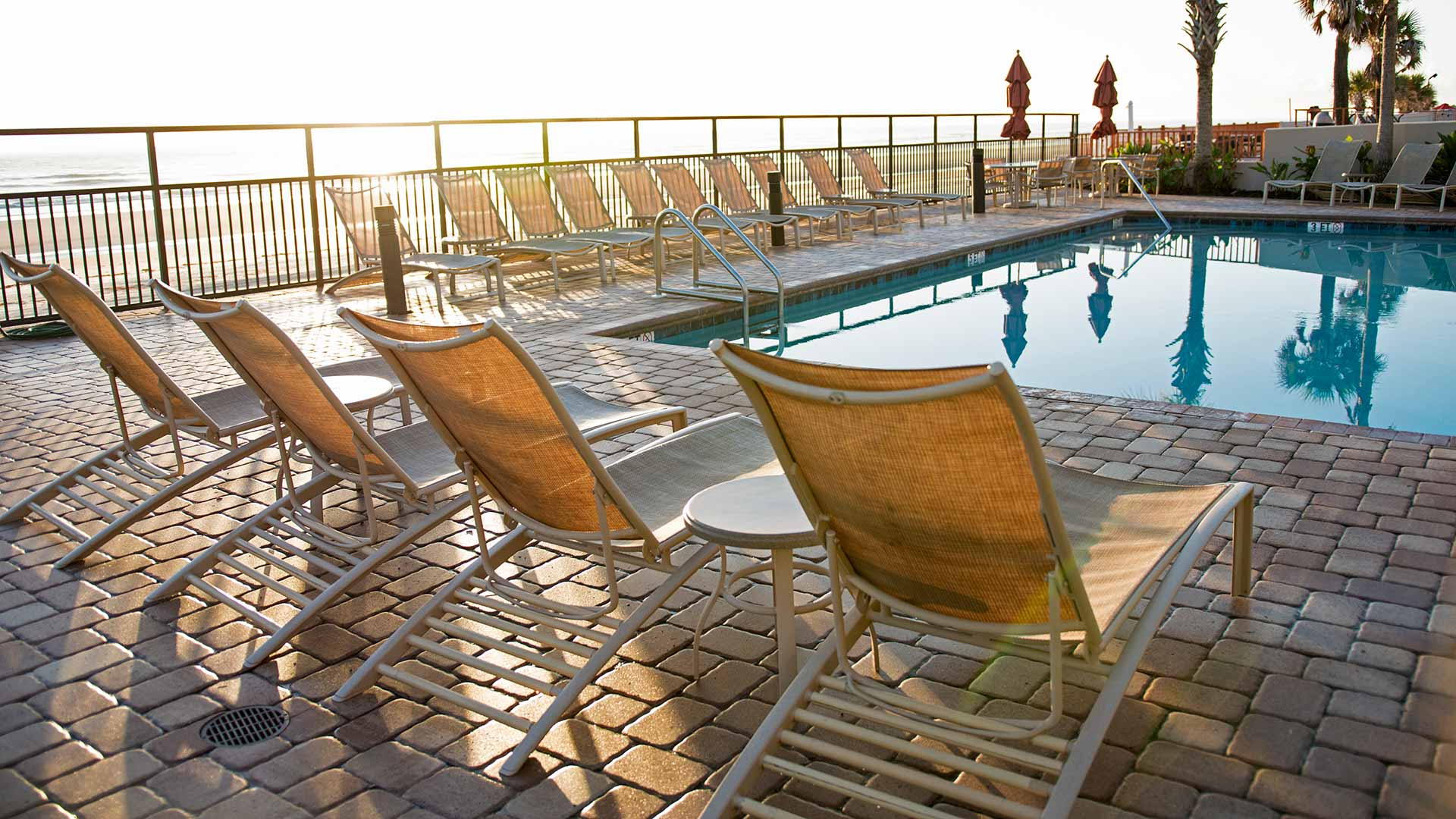scenic view of pool deck area at sunrise